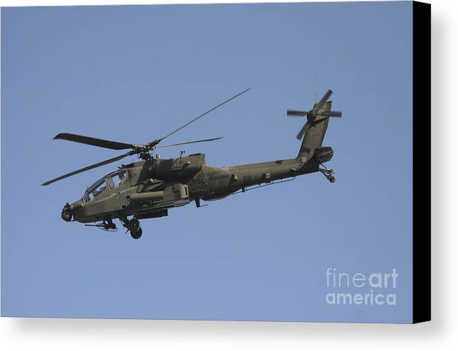 Chain Gun Canvas Print featuring the photograph Ah-64 Apache In Flight Over The Baghdad by Terry Moore