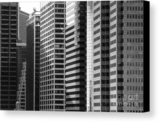New York City Canvas Print featuring the photograph Architecture Nyc Bw by Chuck Kuhn