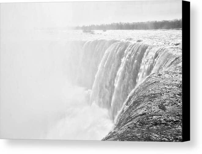 The Canvas Print featuring the photograph At The Edge Of Horseshoe Falls In Black And White by Bill Cannon