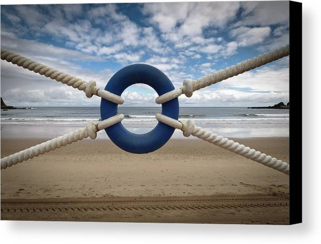 Horizontal Canvas Print featuring the photograph Beach Through Lifeguard Tied With Ropes by Carlos Ramos
