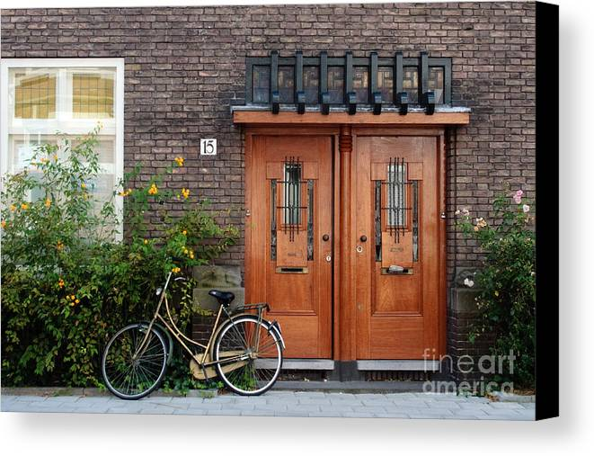 Bicycle Canvas Print featuring the photograph Bicycle And Wooden Door by Thomas Marchessault