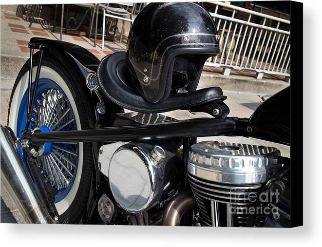 Vintage Canvas Print featuring the photograph Black Vintage Style Motorcycle With Chrome And Black Helmet by Jason Rosette