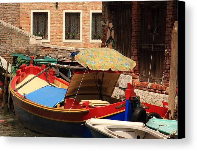 Venice Canvas Print featuring the photograph Boat With Umbrella On Canal In Venice by Michael Henderson