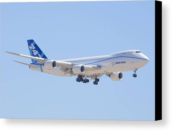 Airplane Canvas Print featuring the photograph Boeing 747-8 N50217 Landing by Brian Lockett