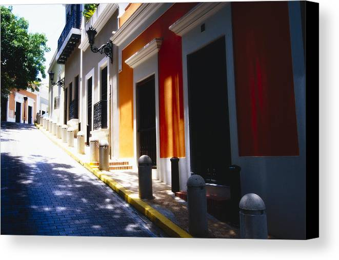 Street Photography Canvas Print featuring the photograph Calle Del Sol Old San Juan Puerto Rico by George Oze