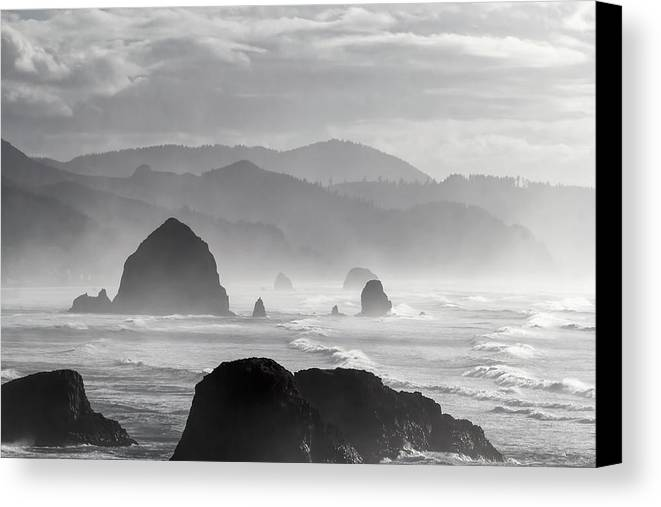 Cannon beach canvas print featuring the photograph cannon beach black and white portrait by david gn