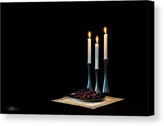 Cherries And Candles In Steel Canvas Print featuring the photograph Cherries And Candles In Steel by Torbjorn Swenelius