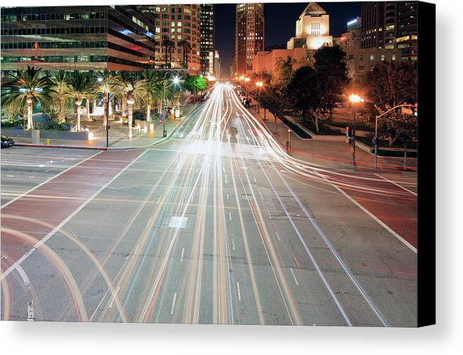 Horizontal Canvas Print featuring the photograph City Light Trails On Street In Downtown by Eric Lo