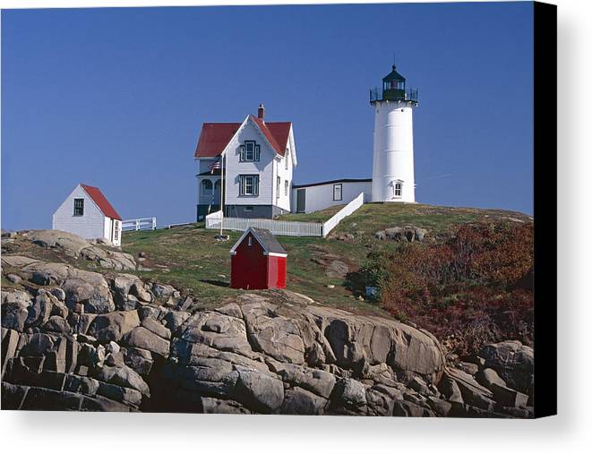 Architecture Canvas Print featuring the photograph Close Up View Of A Lighthouse Cape Neddick Maine by George Oze
