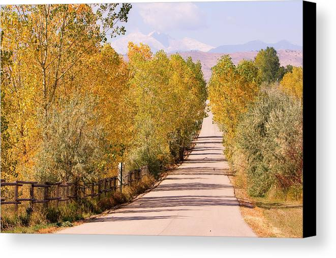 Longs Peak Canvas Print featuring the photograph Country Road Autumn Fall Foliage View Of The Twin Peaks by James BO Insogna