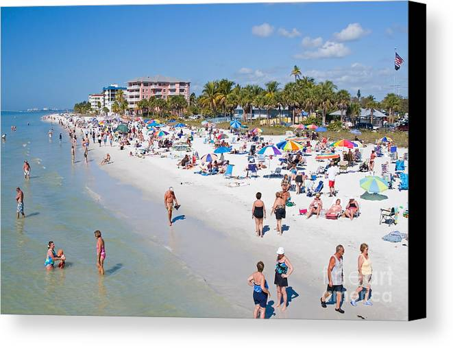 Beach Canvas Print featuring the photograph Crowd On A Summer Beach In Ft Meyers Florida by ELITE IMAGE photography By Chad McDermott