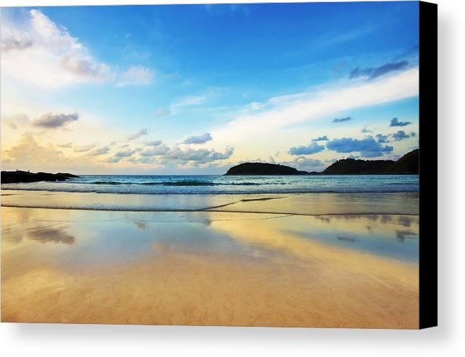 Area Canvas Print featuring the photograph Dramatic Scene Of Sunset On The Beach by Setsiri Silapasuwanchai