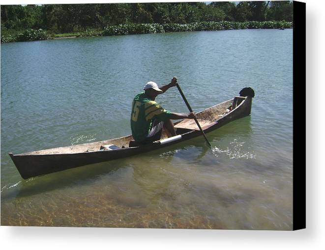 Fisherman Canvas Print featuring the photograph Fisherman On Wooden Canoe by Samanta Munguia