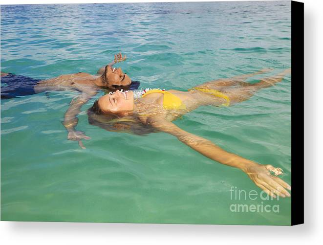 Asian Canvas Print featuring the photograph Floating Young Couple by Tomas del Amo - Printscapes