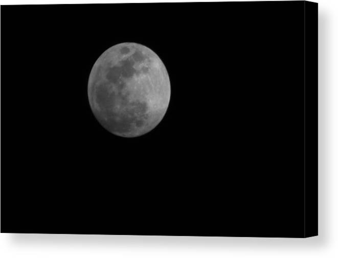 Moon Canvas Print featuring the photograph Full Moon Over Xenia Ohio by Caleb Bynum