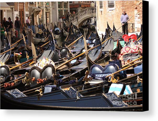 Venice Canvas Print featuring the photograph Gondolas Parked In Venice II by Michael Henderson
