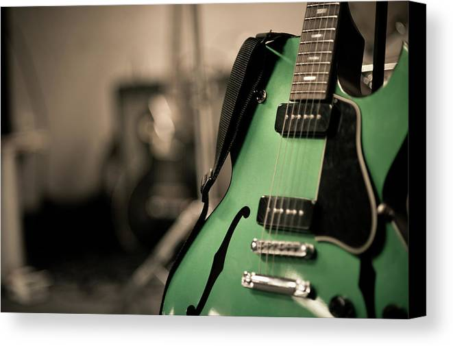 Horizontal Canvas Print featuring the photograph Green Electric Guitar With Blurry Background by Sean Molin - www.seanmolin.com