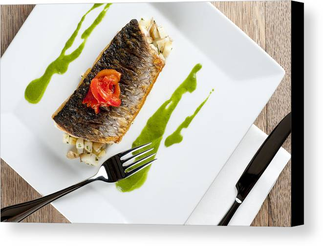 Grey Mullet Canvas Print featuring the photograph Grey Mullet With Watercress Sauce Presented On A Square White Plate With Cutlery And Napkin by Andy Smy