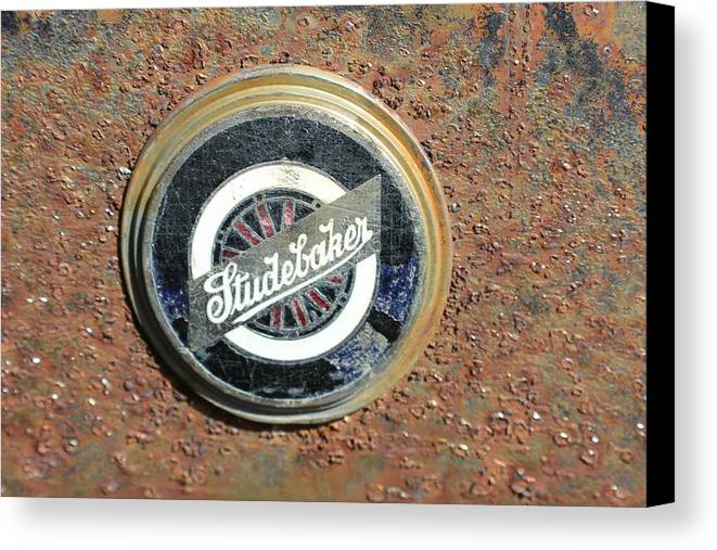 Automobile Canvas Print featuring the photograph Grill Badge by Douglas Miller