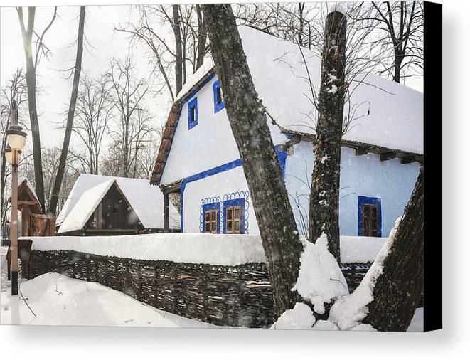 Architecture Canvas Print featuring the photograph Heavy Snow In A Romanian Village by Daniela Constantinescu