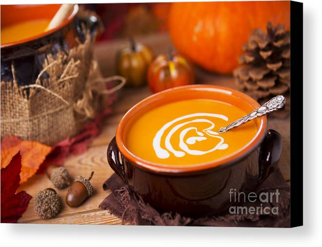 Pumpkin Soup Canvas Print featuring the photograph Homemade Pumpkin Soup On A Rustic Table With Autumn Decorations by Sara Winter