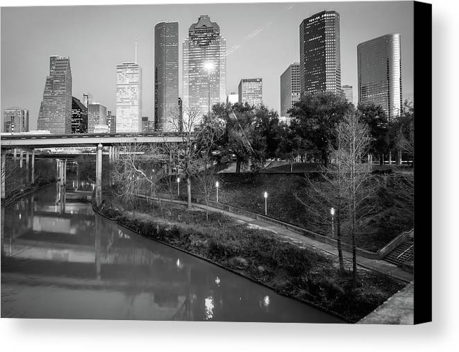 Houston Skyline Canvas Print featuring the photograph Houston Texas Skyline On The Buffalo Bayou - Black And White by Gregory Ballos
