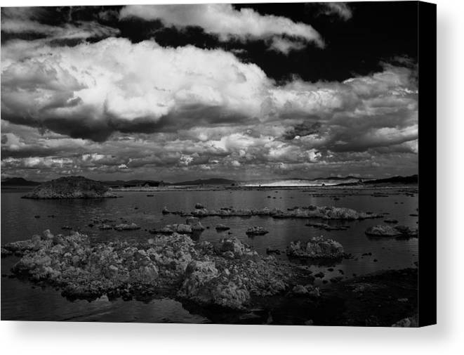 Clouds Canvas Print featuring the photograph Hovering by Jessica Roth