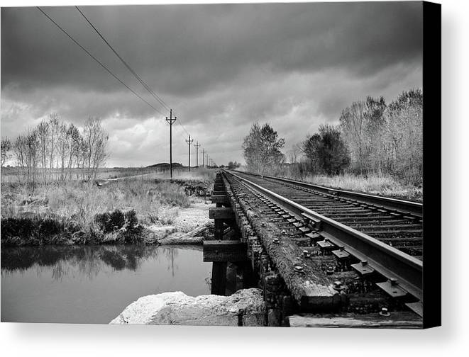 Railroad Tracks Canvas Print featuring the photograph Into The Distance by Matthew Angelo