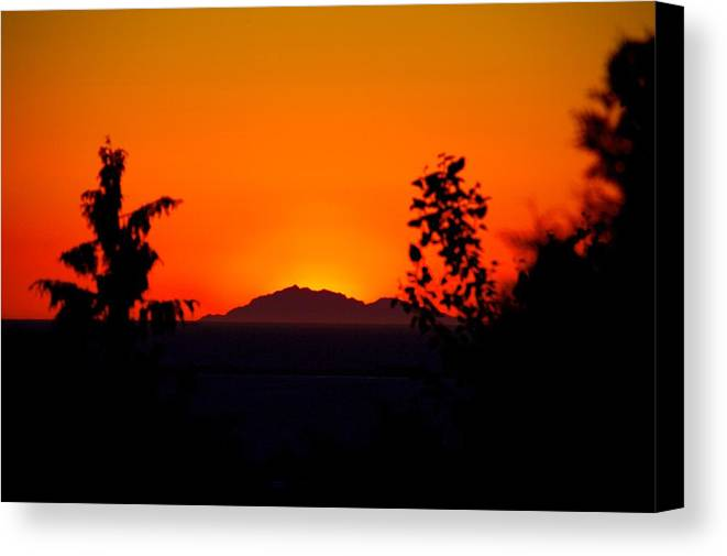 Island Canvas Print featuring the photograph Island Sunset by Paul Kloschinsky