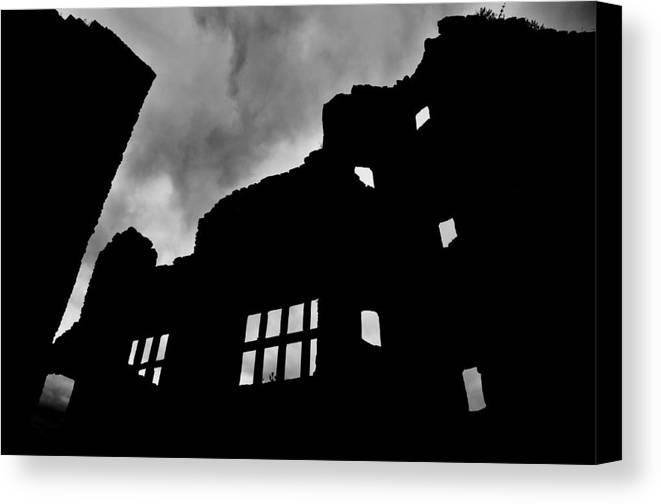 Castle Canvas Print featuring the photograph Ludlow Storm Threatening Skies Over The Ruins Of A Castle Spooky Halloween by Andy Smy