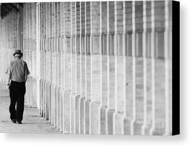 City Canvas Print featuring the photograph Man Walking by Jill Reger