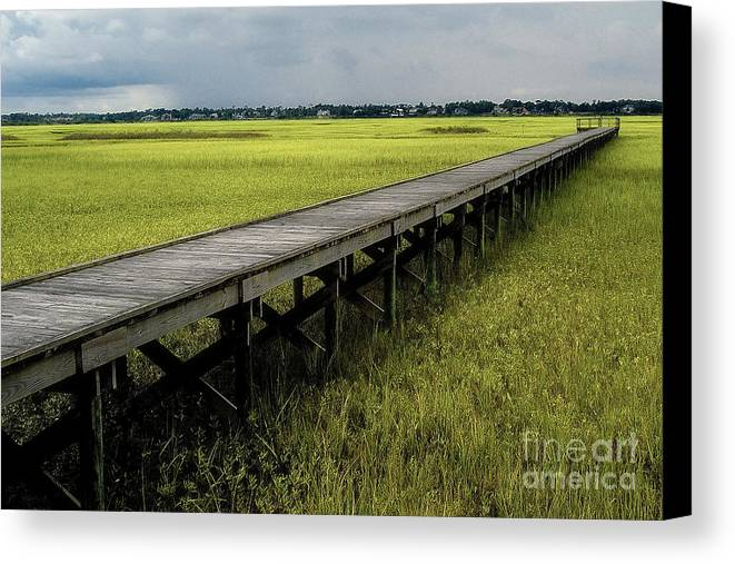 Marsh Canvas Print featuring the photograph Marshland Boardwalk by Neil Doren