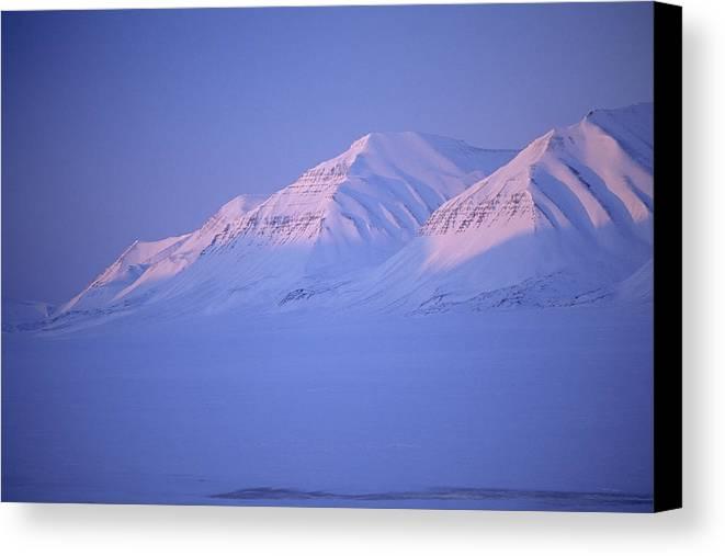 Spitsbergen Canvas Print featuring the photograph Midnight Sunset On Polar Mountains by Gordon Wiltsie