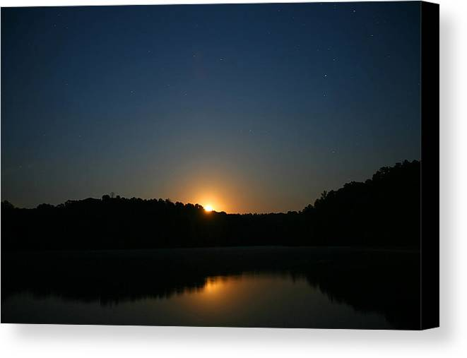 Scenery Canvas Print featuring the photograph Moon Rising Over The Lake by James Jones