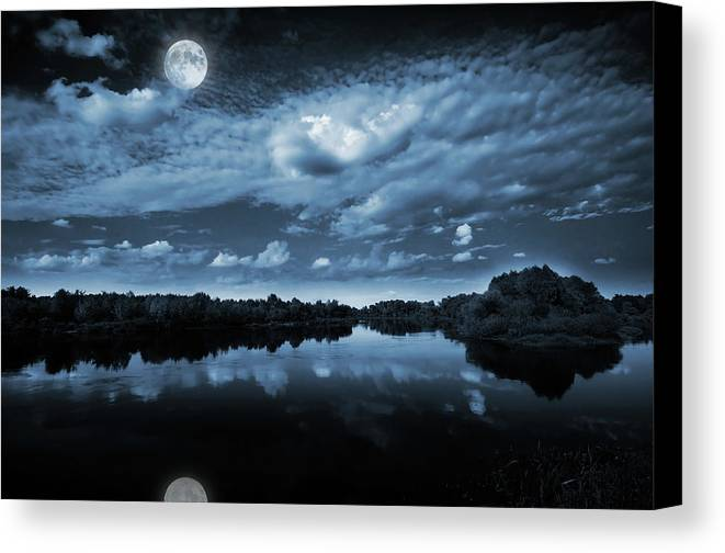 Beautiful Canvas Print featuring the photograph Moonlight Over A Lake by Jaroslaw Grudzinski