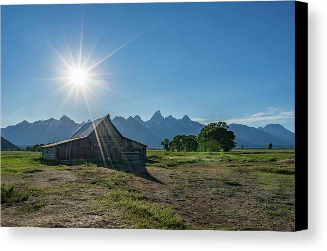 Grand Canvas Print featuring the photograph Mormon Row by Alpha Wanderlust