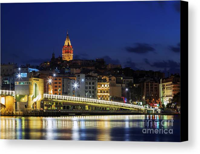 Ancient Canvas Print featuring the photograph Night View Of Galata Bridge And Galata Tower. by Mohamed Elkhamisy