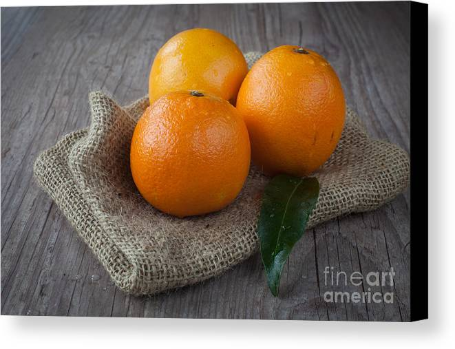 Tangerine Canvas Print featuring the photograph Orange Fruit by Sabino Parente