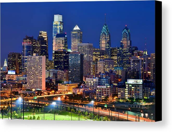 Philadelphia Skyline At Dusk Canvas Print featuring the photograph Philadelphia Skyline At Night by Jon Holiday