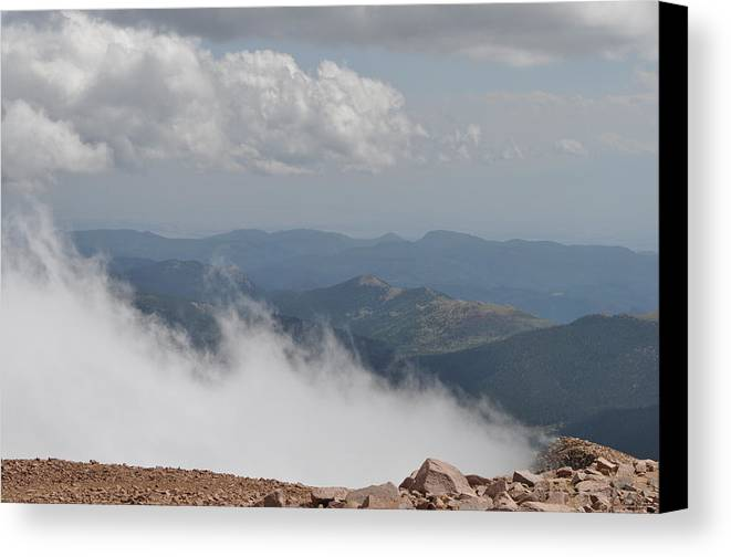 Clouds Canvas Print featuring the photograph Pikes Peak Summit Clouds by Karen Freeman