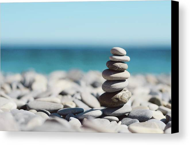 Horizontal Canvas Print featuring the photograph Pile Of Stones On Beach by Dhmig Photography
