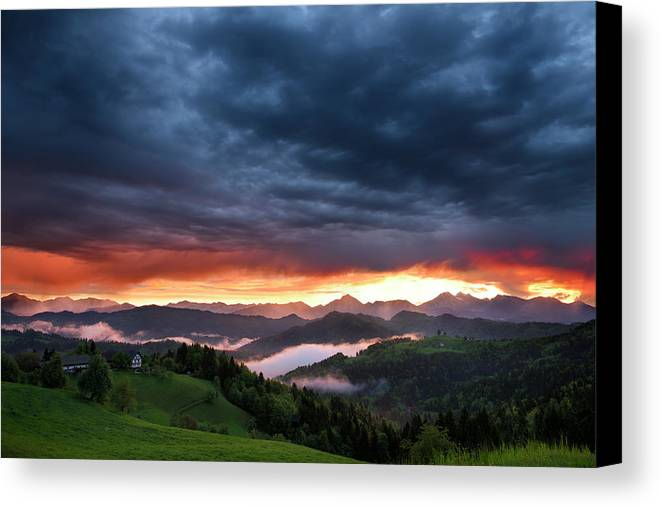 Sunrise Canvas Print featuring the photograph Pink Sunrise And Blue Clouds In The Mountains Of Kamnik Savinja by Reimar Gaertner