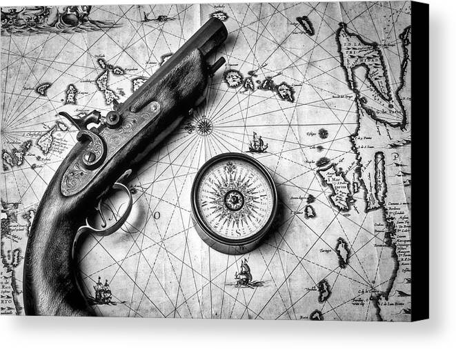 Old Canvas Print Featuring The Photograph Pistole And Compass On Map In Black White