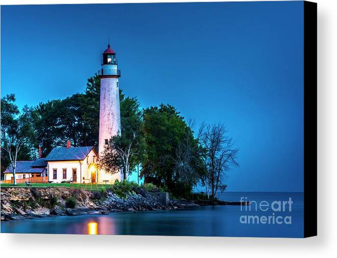 Pointe Aux Barques Lighthouse Canvas Print featuring the photograph Pointe Aux Barques Lighthouse At Dawn by Larry Knupp