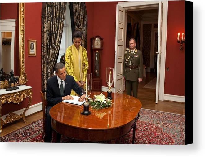 History Canvas Print featuring the photograph President Obama And Michelle Obama Sign by Everett