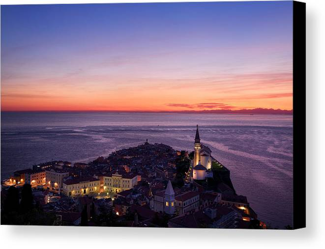 Piran Canvas Print featuring the photograph Purple Light On The Adriatic Sea After Sundown With Lights On Pi by Reimar Gaertner