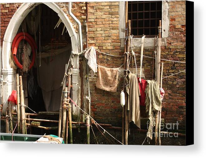 Venice Canvas Print featuring the photograph Raggedy Door On Canal In Venice by Michael Henderson