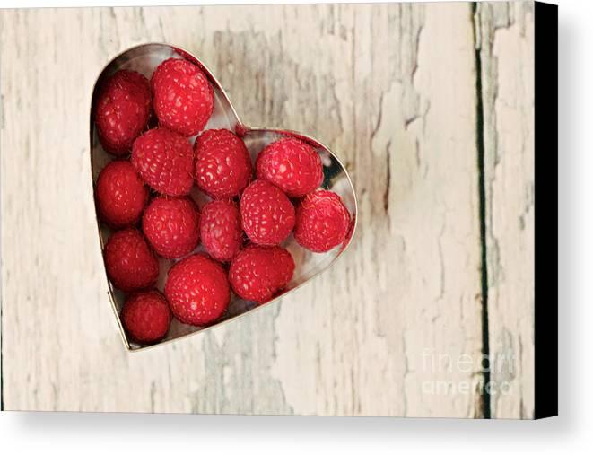 Raspberry Canvas Print featuring the photograph Raspberry Heart by Kim Fearheiley