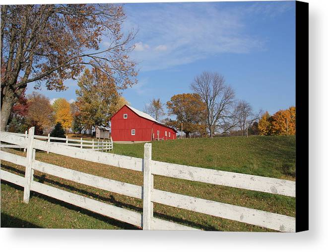 Red Canvas Print featuring the photograph Red Amish Barn by Donna Bosela