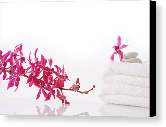 Spa-treatment Canvas Print featuring the photograph Red Orchid With Towel by Atiketta Sangasaeng